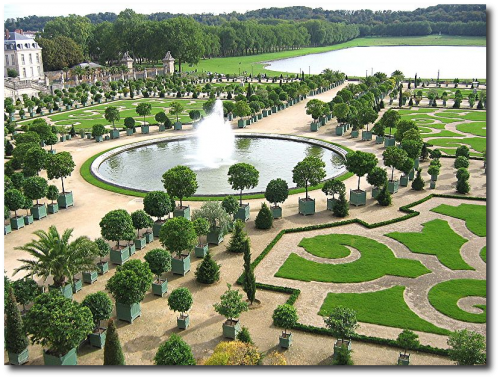 The Orangerie in the gardens of the Palace of Versailles with the Pièce d'Eau des Suisses in the background 500x379 French Gardens