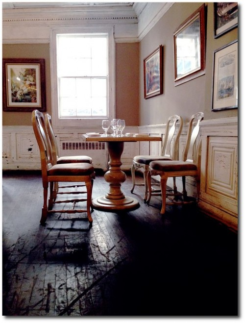 Fraunces Tavern white dentil crown molding light brown walls white chair rail and paneling black floors 500x659 Decorating With Dark Brown  French Styling